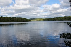 Lake in the forrest (trankoket) Tags: wood sky cloud lake reflection nature water beautiful beauty forest landscape outside outdoors scenery europe quiet peace natural sweden schweden country peaceful swedish waters outlook nordic typical scandinavia scandinavianlandscape