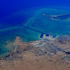 Dredged Doha, top of the Qatar peninsula (window seat 1), September 2012 (5telios) Tags: sea plane square fly flying nikon desert flight squareformat nikkor qatar windowseat 1855mmf3556gvr nikond3100