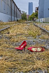 A Pair of Shoes (Kool Cats Photography over 8 Million Views) Tags: railroad red stilllife streetart abstract art oklahoma grass shoes artistic tracks