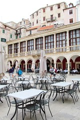 on the square (green_lover) Tags: šibenik szybenik croatia architecture buildings history town restaurant tables chairs square arches travels