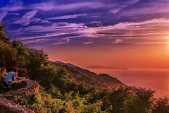 Down The Castle (PokemonaDeChroma) Tags: spain donostia sansebastian mountain mountainside sunset sky cloud people couple sitting canoneos6d bright vibrant plant grass summer august 2016 mont igueldo castle turret warm warmth