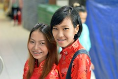 chinese new year's beauties (the foreign photographer - ฝรั่งถ่) Tags: two pretty young women braces chinese new years red dresses yingcharoen market sapan mai bangkhen bangkok thailand nikon d3200 mouth jewelry