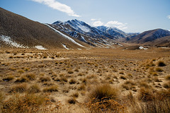 White Capped Tundra Near Lindis Pass ([ dg ]) Tags: new blue winter sky snow cold grass landscapes wind air pass zealand alpine otago peaks frigid desolate barren tussock tundra lindis
