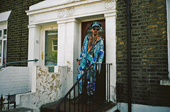 I'm just popping out for some milk. (deepstoat) Tags: blue london film hat zeiss 35mm doorway deptford contaxt3 jumpsuit kodakportra400 afteritookthiswehadachatandaverynicemanhewastooithinkhesaidhisnamewasnoisypirate