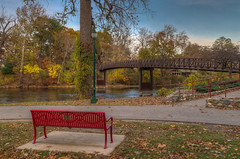 """Anyone care to take a turn in the """"hot seat?"""" (tquist24) Tags: autumn trees red sky tree leaves bench geotagged leaf nikon unitedstates footbridge indiana elkhart hdr hbm islandpark stjosephriver nikond5300"""