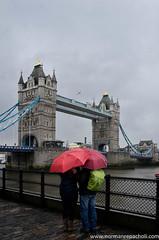 Umbrella admiration - Tower Bridge - London - Britain (Keystone Photography) Tags: uk red england urban storm colour london history rain umbrella towerbridge vintage landmark tourist keystone capitalcity pentaxk5 repacholi