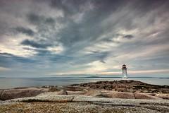 Peggy's Cove Lighthouse (Dan Fleury Photos) Tags: ocean sea sky lighthouse seascape canada clouds canon landscape novascotia cove shoreline rocky shore maritime halifax