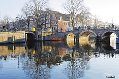Amsterdam. (alamsterdam) Tags: amsterdam bridges people bikers canal water reflections boat
