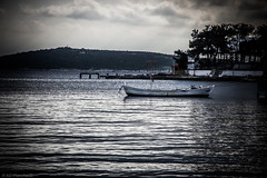 Tethered (Anthony P26) Tags: boat category erdek places seascape transport travel turkey travelphotography canon1585mm canon70d canon coast coastal coastline harbour waves water bay marmarasea turkiye landscapephotography island sky outdoor cloudysky