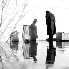 By greeting his shade (pascalcolin1) Tags: paris13 pluie rain reflets reflection homme man chapeau hat ombres shadows saluant greeting photoderue streetview urbanarte noiretblanc blackandwhite photopascalcolin