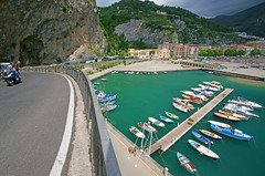 A view of Porto di Maiori, Maiori Harbour and Maiori Amalfi Coast, Campania ,The province of Salerno, Italy, Italia (Minoltakid) Tags: road travel blue italy water fence buildings boats boat town seaside europe italia campania amalficoast harbour bluewater may eu it moped 27th 2014 maiori geotaged colourfulbuildings portodimaiori rossevans provinceofsalerno minoltakid theminoltakid rossdevans maioriharbour italiansaeside