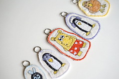 embroidered key pendants (cernaovec) Tags: thread penguin handmade embroidery sewing textile fabric cotton accessories hippo textiles fiber tux embroidered freemotionembroidery sewn luckycharm