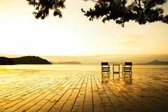 The awaited sunrise (Naoshima Island, Japan) (Alex Stoen) Tags: travel vacation art lines silhouette japan set museum architecture sunrise geotagged golden vanishingpoint google couple flickr chairs terrace infinity pair horizon profile deck kagawa facebook naoshimaisland puntodefuga natgeo benessehouse nationalgeographicexpeditions creativecomposition alexstoen alexstoenphotography canoneos1dx ef2470mmf28liiusm ngexpeditions