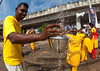 Hindu Pilgrim Collecting Water In A Jar In Annual Thaipusam Religious Festival In Batu Caves, Southeast Asia, Kuala Lumpur, Malaysia (Eric Lafforgue) Tags: travel pierced people men water yellow festival horizontal religious outdoors shower drops women asia southeastasia day indian faith religion ceremony piercing parade event malaysia devotion pierce ritual kualalumpur spirituality devotee endurance hindu hinduism malaysian groupofpeople cultures pilgrimage batu thaipusam hindi selangor decorated placeofworship penance traveldestinations lookingatcamera kl177
