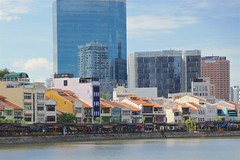 Boat Quay with restaurants and shop houses by the Singapore river