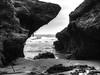 Between a Rockand a Hard Place. (Grumpy O M) Tags: rocks sea seaweed photomatrix monochrome canonpowershots120 breakingwaves