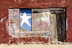 Old Door and Window (photographyguy) Tags: door window wood star weathered sidewalk bricks texas amarillo building texasstateflag texaspanhandle peelingpaint lonestar