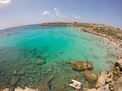 Cala Rossa n03 (Ivan S. Almeida) Tags: sea seaside seascape shore blue water green cristalclear hill serene cloudless sky italy sicily gopro