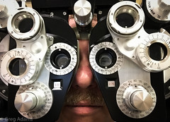 Lots of Lenses (Greg Adams Photography) Tags: borgcontinuum assimilated lens lenses selfportrait eyeexam me numbers dials hhsc2000 2017 face exam medical optical office doctor
