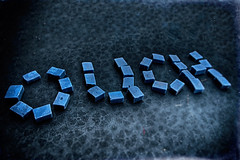 Black And Blue (hbmike2000) Tags: blue black glass catchycolors dark paper ouch tile word typography nikon shadows mosaics d200 hdr odc blueandblack asplashofcolor hbmike2000