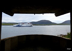 The Hamnavoe Ferry In Hoy Sound (orquil) Tags: uk greatbritain autumn ferry logo island islands scotland seaside orkney september hills sound hoy searchlight viking defence roro wartime emplacement hamnavoe northlink graemsay shippingchannel