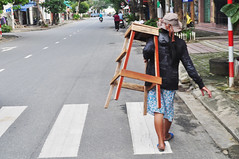 Personal delivery (Roving I) Tags: women workers carrying loads woodenfurniture stools street sunhats danang vietnam