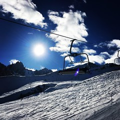 Sun flare (Laurian Guy) Tags: vacation holiday mountain snow ski sunflare flare clouds skiing sun white blue