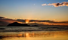 Barely risen (lizcaldwell72) Tags: hawkesbay newzealand waimaramabeach cloud reflection sky beach sunrise water bareisland light
