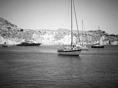 Lindos (kissszabi) Tags: ocean travel sea blackandwhite bw bay boat seaside fuji yacht aegean greece fujifilm rodos rhodes lindos x10