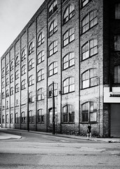 Wheeling, West Virginia (G. L. Brown) Tags: urban blackandwhite bw west building monochrome architecture contrast virginia industrial factory shadows decay candid streetphotography gritty storefront signage grainy wheeling