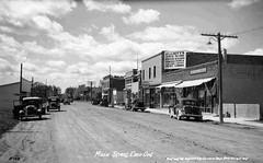 Main Street (Emo, Ontario) (TBayMuseum) Tags: ontario canada history cars mainstreet emo vehicles transportation drugstore streetscenes businesses gasstations