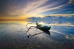 The Jukung (adi77aw) Tags: sea sky bali beach skyline clouds sunrise reflections boat seascapes sanur karang pantaikarang
