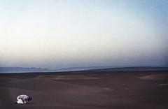 A man prays in the Sahara Desert outside of Morocco