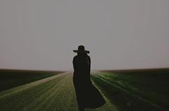 (emmakatka) Tags: road shadow portrait woman girl hat self dark scary alone horizon ghost country dream surreal creepy spooky dirt figure northdakota lonely gravel blackhat blackdress allblackeverything emmakatka