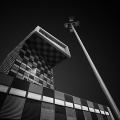 discourse (gkphotography.lt) Tags: architecture abstract blackandwhite lamppost college shipping transport longexposure silverefexpro skancheli discourse angle netherlands holland alone building city diagonal fuji fujixt1 forms geometry grid lines minimalistic minimal minimalism sky lookup light landscape leefilter lee monochrome modern nd pov perspective square rotterdam shapes stopper tilted urban view windows