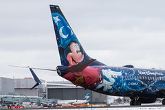 Westjet Disney Magic Plane (biegalskiphotography) Tags: red yyz cgwsz plane 737 b737 boeing westjet disneymagicplane disneyplane waltdisney waltdisneyworld canon 6d c6d toronto airport torontopearson taxing