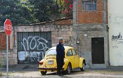 Waiting For The Bus (Erick Flores Diaz) Tags: car stop sign yellow beatle oldman urban street
