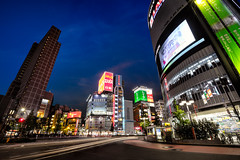 Shinjuku Dori, Tokyo (Patrick Foto ;)) Tags: street city sky people urban building station japan shop skyline night japanese tokyo store shinjuku colorful commerce cityscape view dusk pavement district crowd ad pedestrian illuminated advertisement business company sidewalk commercial jp kanto crowded shinjukuku tkyto