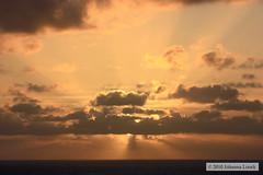 Rays of Sunset (At Sea) (runintherain) Tags: light sunset sky sun water clouds europe shadows atlanticocean fromsea canonxsi canon450dxsi runintherain