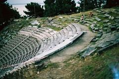 Amphitheater (trinidalitism) Tags: old city travel summer vacation holiday green film tourism nature analog canon tour kodak greece analogue traveling canonae1 archeology timeless romanamphitheatre thassos analoguecamera analogcamera makedonia filmisnotdead analoguephotography thassosisland kodakektar100  macedoniagreece