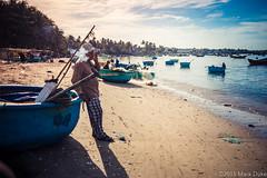 the fisherman (Mark Duke) Tags: sky net clouds relax boats fisherman smoke