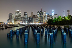 New York Stumps (Hemzah Ahmed) Tags: city nyc newyorkcity urban usa newyork water brooklyn night america skyscraper canon river us nightimages cityscape nightscape skyscrapers unitedstates manhattan unitedstatesofamerica worldtradecenter wide cityscapes brooklynheights wideangle nighttime nightlight brooklynbridge 7d eastriver nightlife waterside lowermanhattan nightscapes wideview canon1022mm canon1022 nycstreetphotography urbannewyork noflashnightshots newyorkphotography nocturnesnightphotography canon7d planet7d