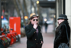 Oral Vices (Ian Sane) Tags: ian sane images oralvices man woman cigarette smoking cell phone talking candid street photography downtown portland oregon southwest 5th avenue morrison canon eos 5d mark ii two camera ef70200mm f28l is usm lens