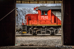 CN 7510   EMD GP38-2   CN Memphis Subdivision (M.J. Scanlon) Tags: rail railroad railway canadian national iliinois central engine locomotive track power horsepower red canada train transportation memphis tennessee mississippi work outdoor outdoors vehicle unit scanlon canon 7d gloomy cloudy abandoned building door opening open truck wheel wheels steel bell
