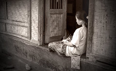 Behind The Beach Series V2 (The Brickest) Tags: poor island beaches huts village indo indonesia southasia girl ponderng door entrance sitting local thinking lifeisnteasy writing journal pen