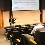 Dr. Perttu playing violin at Faculty Forum.