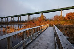 attikamek trail, sault canal national historic site (twurdemann) Tags: bridge autumn mist ontario water weather fog architecture sunrise dawn fallcolors boardwalk marsh wetland saultstemarie fallcolours internationalbridge stmarysisland stmarysriver nikcolorefex saultcanal attikamektrail procontrast 06ndsoftgrad gnd2s xf14mm leeseven5 fujixt1 fall2015