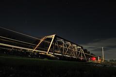 night bridge (zimwizdotcom) Tags: longexposure bridge sky night train stars landscape nikon ns noflash nighttime headlight railroadbridge freighttrain norfolksouthern conrail d300 railraod readingrr lurganbranch nightoneearth