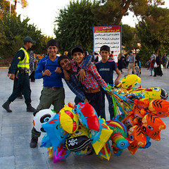 Boys in the square next to the Shrine of Fatimah al Masumeh, Qom, Iran (berengere.cavalier) Tags: balloons shrine iran balloon bob spongebob sponge qom holyshrine iranianboys