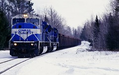 Northwoods Thunder (Hoist!Man) Tags: csx conrail wc wisconsincentral cn canadian national emd sd80mac train minorca railroad winter snow wisconsin film pentax